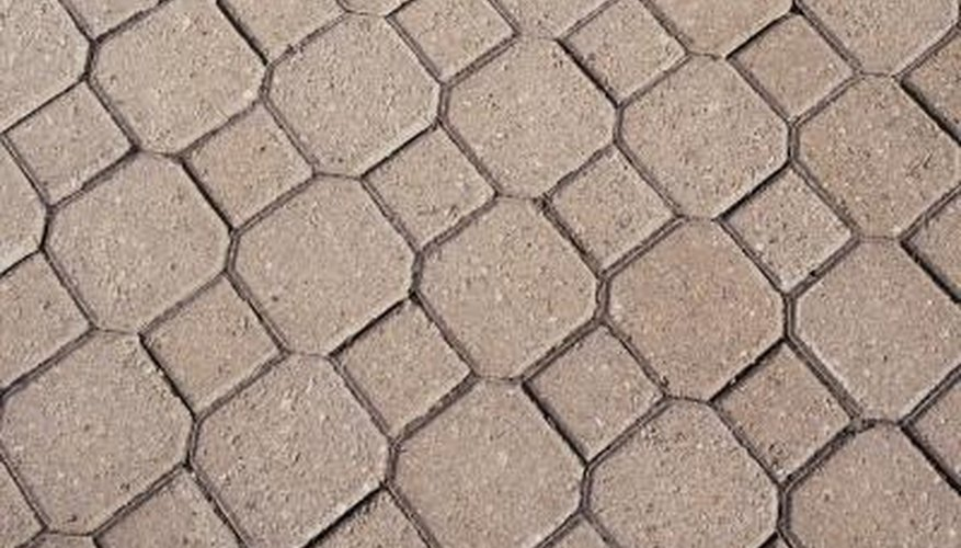 Polyurethane placed onto stone pavers provides a wear layer protecting the surface.