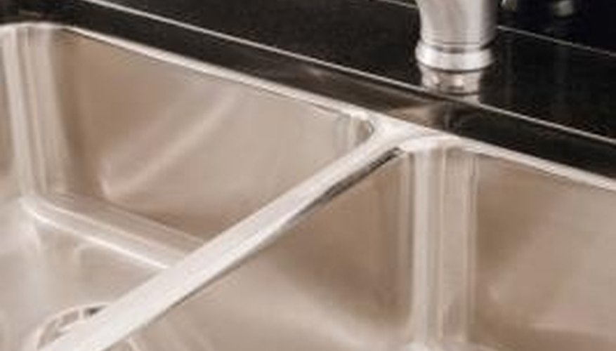 Garbage disposals are attached to the underside of the sink drain.