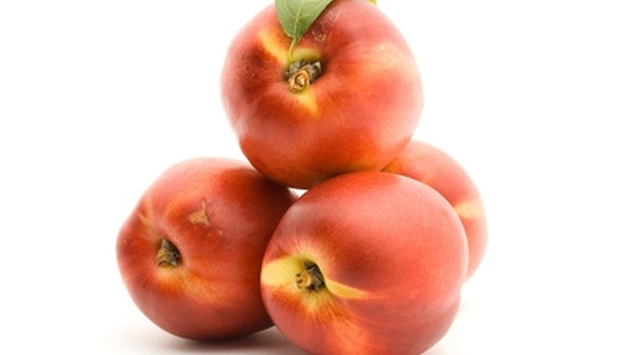 Select hardy varieties to successfully grow peach trees in Missouri.