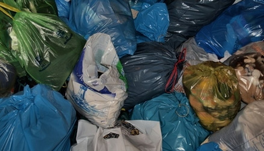 Plastic bags are used to carry items and to dispose of trash.