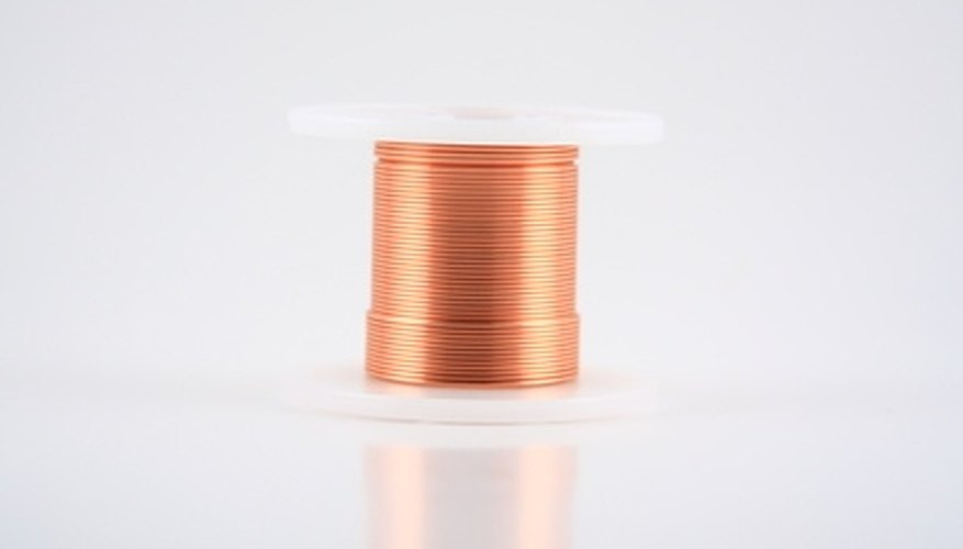 Copper wire is used to provide a ground for an outlet.