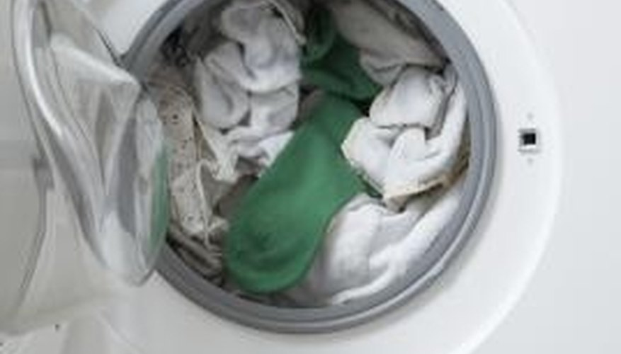 Vinegar removes buildup and mold, leaving your washing machine clean and fresh.