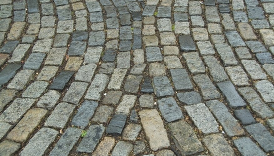 You can calculate the required number of pavers by dividing the walkway area by the area of the pavers.