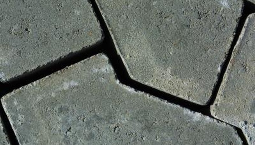 Fill the joints in your patio with mortar for a long-lasting hold.