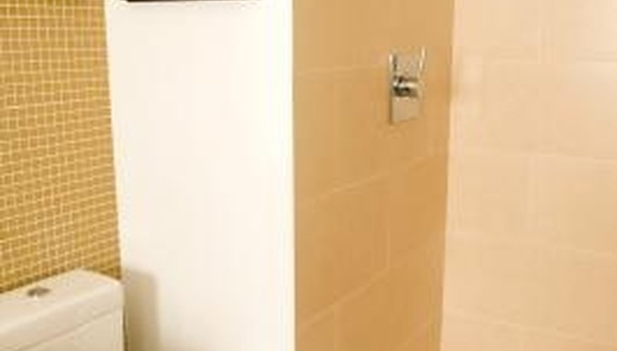 Clean mineral deposits off shower grout with white vinegar.
