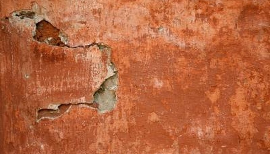 Flaky paint on interior walls is unsightly and prevents new paint from adhering.