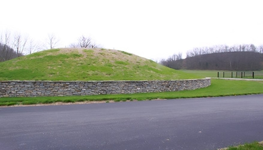 Building an earth berm can create slopes and raised ground in flat landscaping.