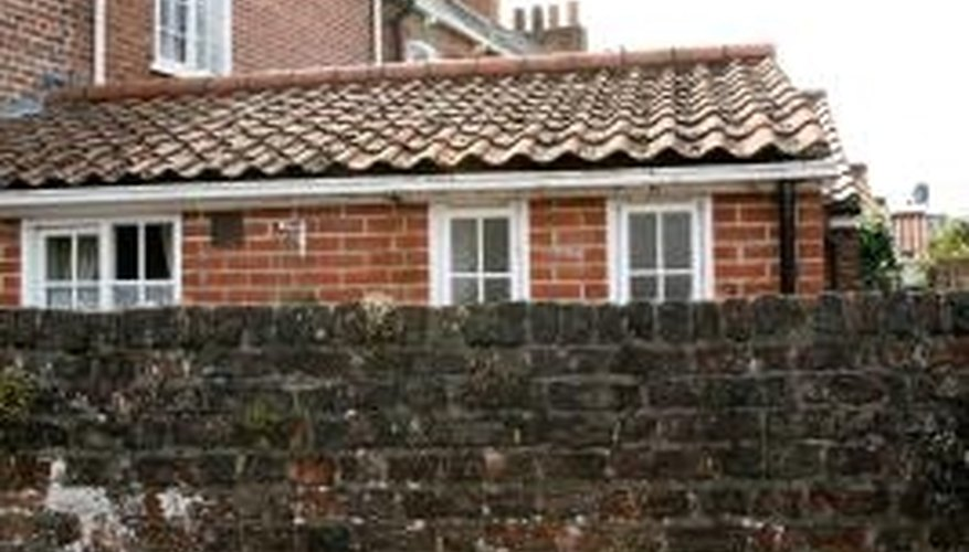Clay stains on textured brick are difficult to remove.