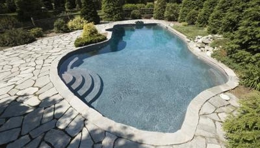 Natural pools embrace assymetrical shapes and natural materials.