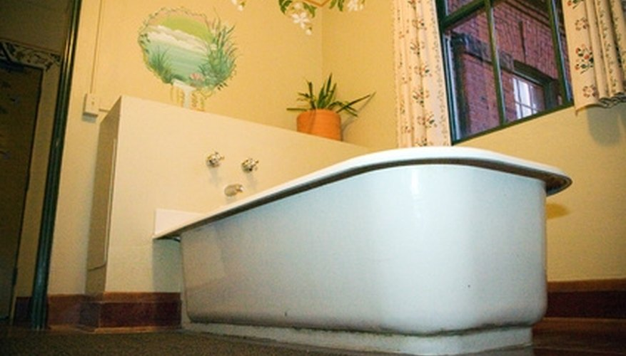 Use latex caulk to protect your vinyl floor from leaks in the bathtub.