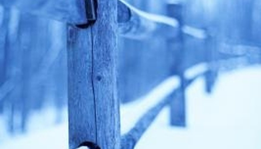Set wood fence posts below the frost line.