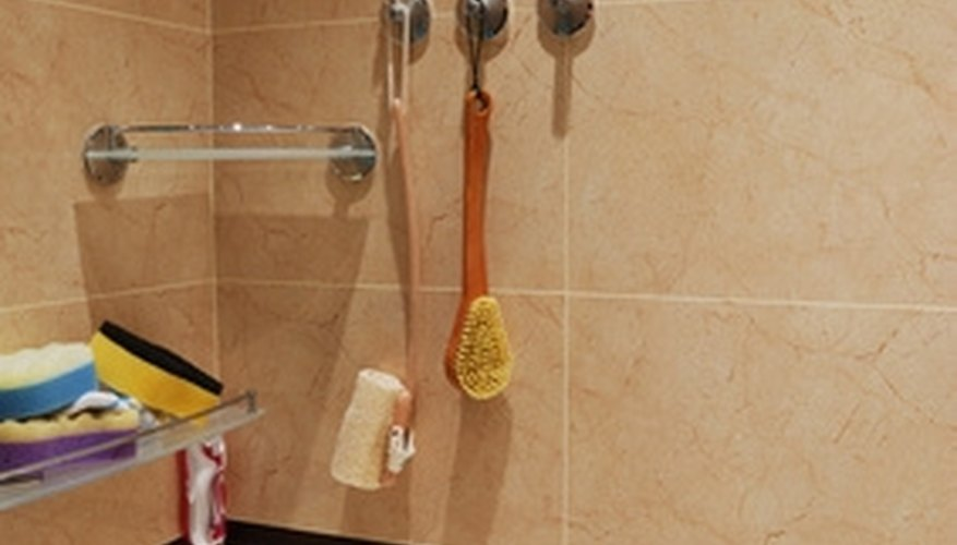You can use everyday household products to bring the shine back to ceramic shower tiles.