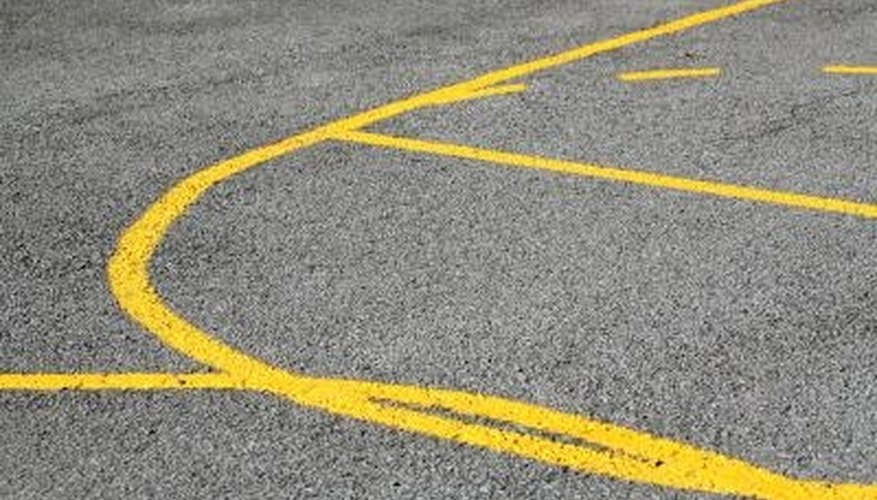 Backyard basketball court lines can be made with or without stencils.