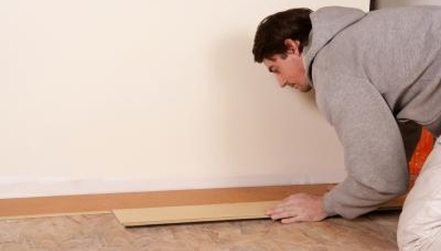 A chalk line helps you start the floor installation on a straight line.