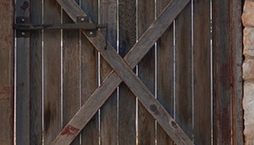 Mounting a gate over sloped land may be challenging.