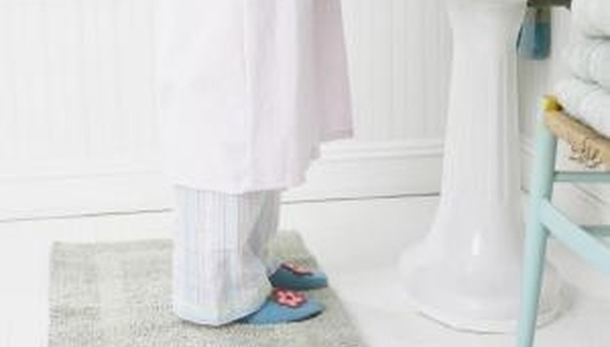 The rubber backing of simple bath mats can leave rubber stains on tile.