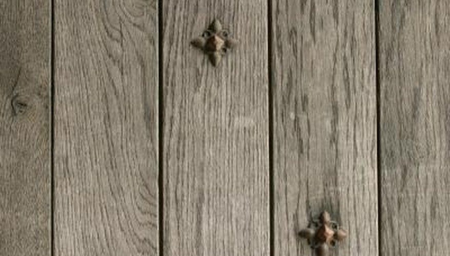 Restore color to a gray fence with wood stain.