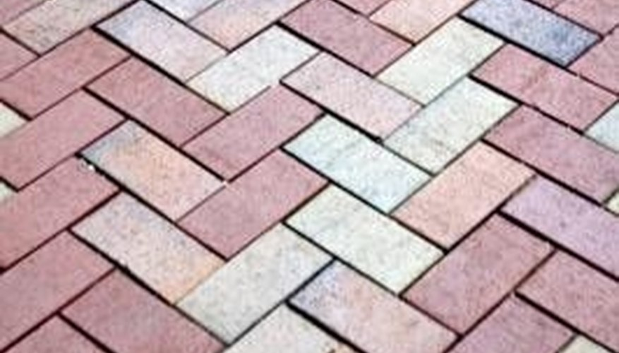 Herringbone is a common pattern for brick-shaped pavers.