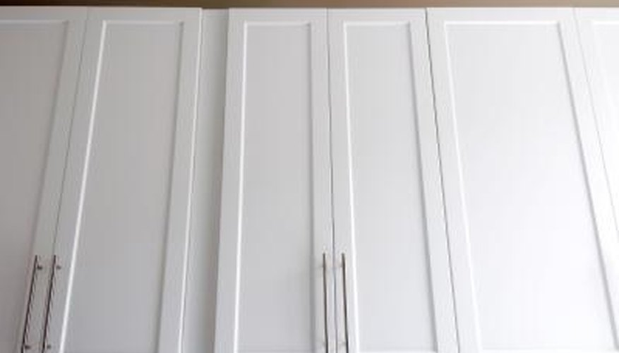 Adding new hardware can add a modern look to your recently refinished cabinets.