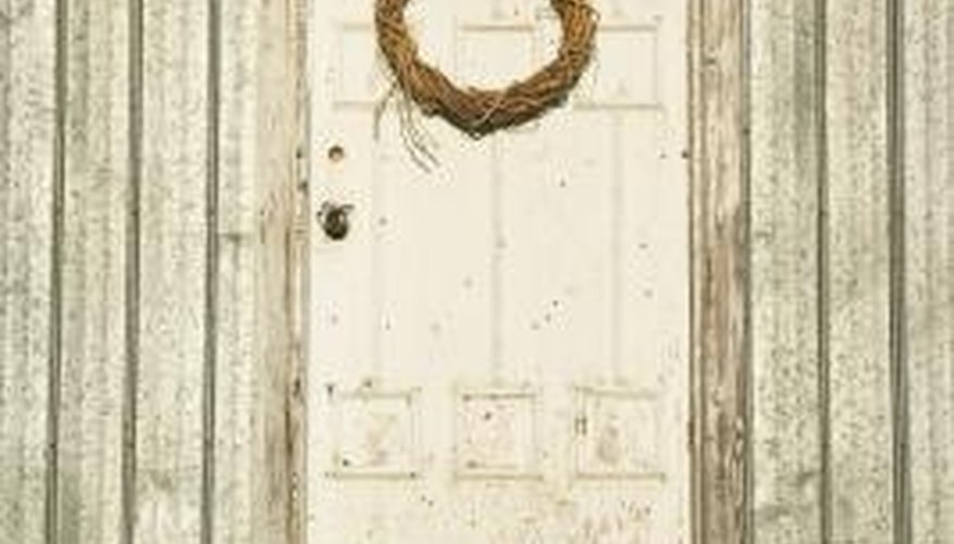 Chipping paint and a simple wreath convey rustic charm.