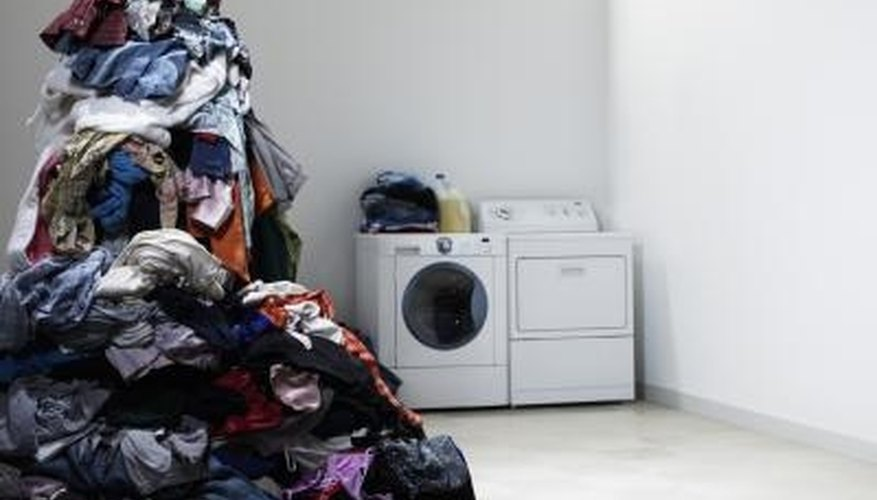 Laundry can pile up if your front-load washer isn't working due to a jam.