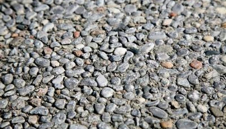 Gravel will help water reach the bottom of the drain quickly.