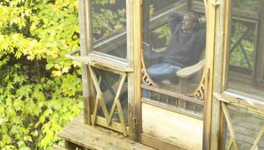 Screens keep insiects from bothering porch occupants during summer relaxation.