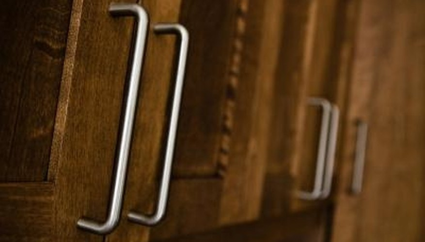 Remove cabinet hardware before pickling the cabinets.