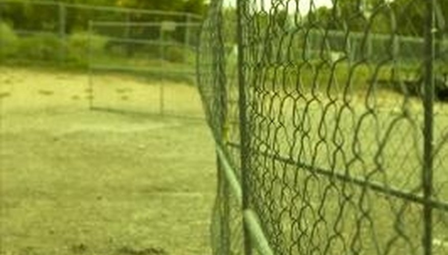 You can reuse chain link fence posts if you are careful when you remove them from the ground.