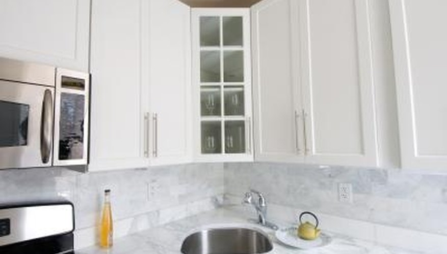 Add a few doors with glass fronts and new hardware for a fast remodel.