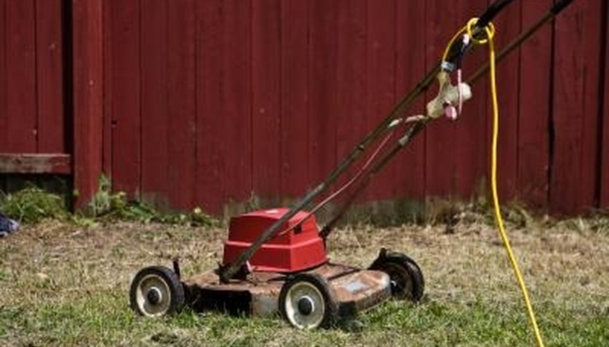 The electric motor on your lawnmower hums but doesn't start because of a problem with the start winding circuit.