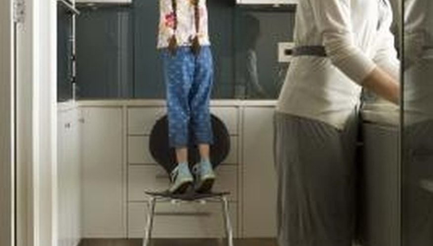 Portable steps are good for children who cannot reach the top kitchen cupboard.