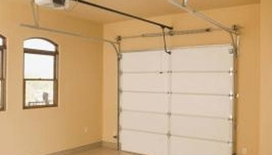 Use a hanging cord to manually open the garage door.