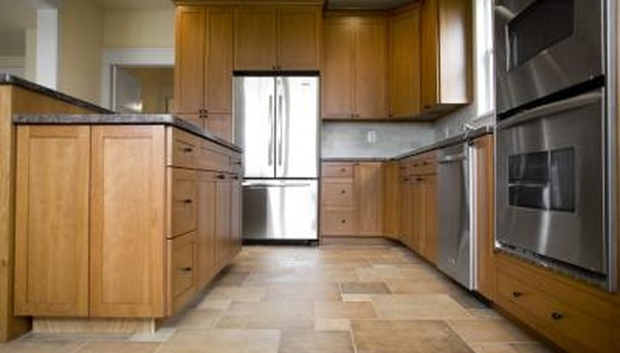 Caulking protects the space between tile and a cabinet or baseboard.