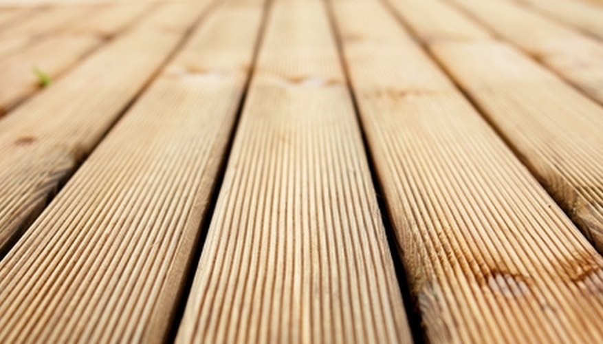 Deck cleaners contain chemicals to remove discoloration, mildew and dirt.