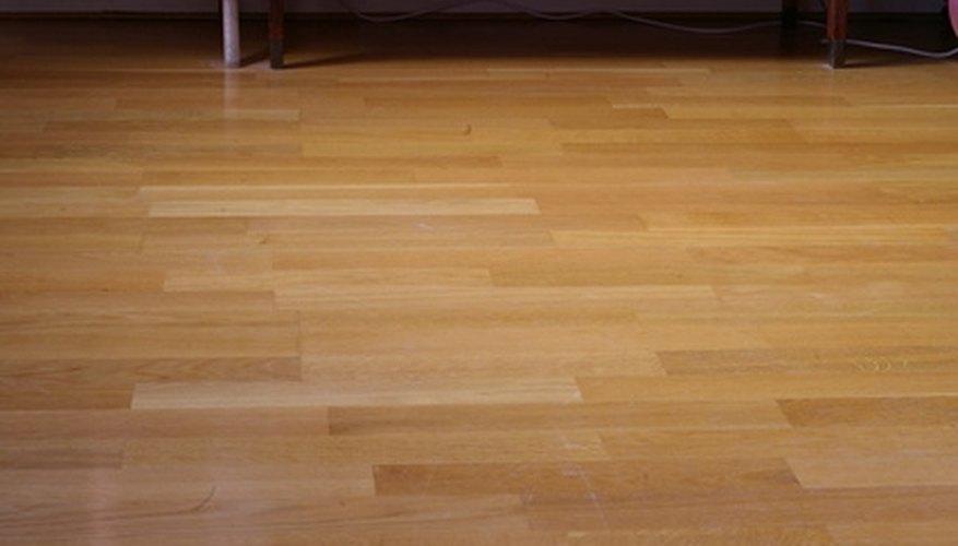 Laminate flooring rests on a foam underlayment.