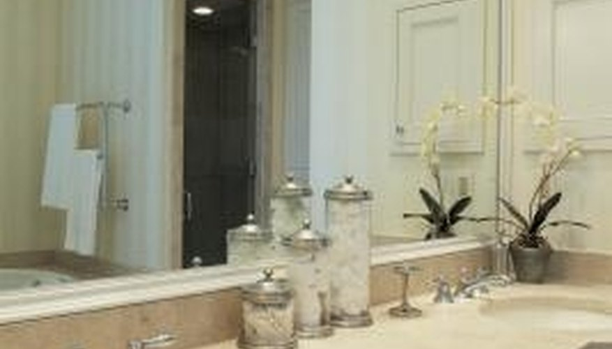 Improve the appearance of your bathroom by refurbishing the cabinets.