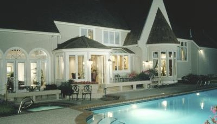 A well-lit pool complements the landscaping in your backyard.