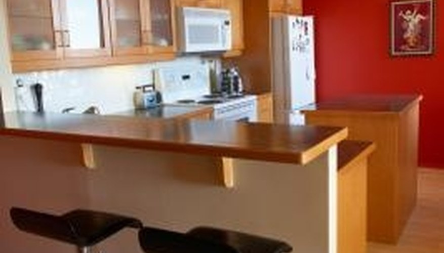 Change the look of your countertops with the application of a metal trim.