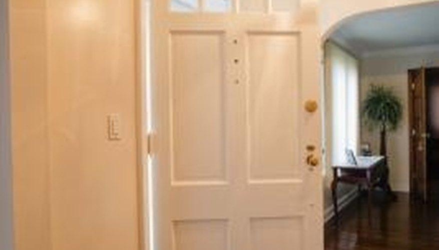 Plumb a door jamb to improve the operation of the door. & How to Plumb a Door Jamb | HomeSteady Pezcame.Com