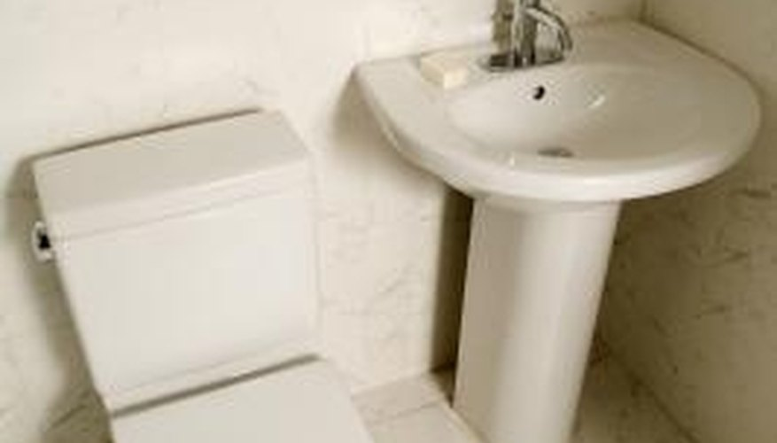 Low-flush toilets use less than half the water that older ones do.