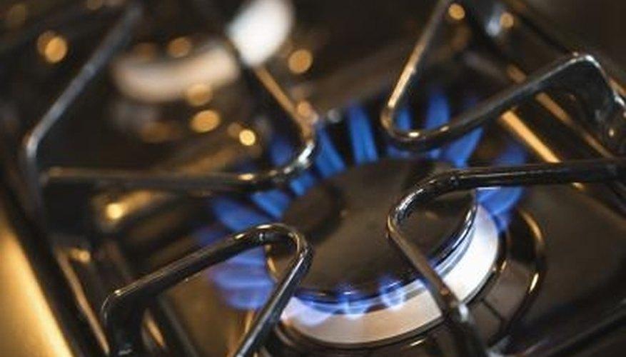 Adjust a gas burner until it produces a clean blue flame.