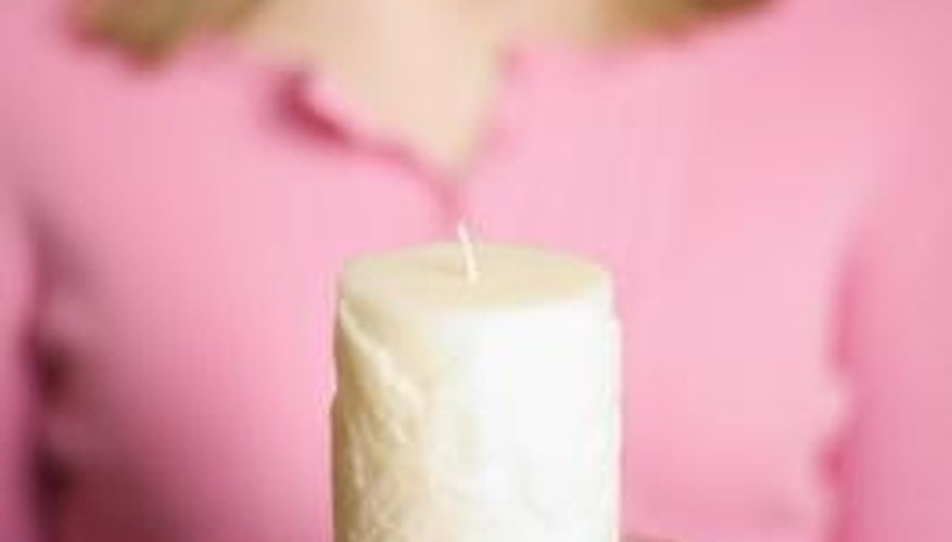 Use tulle and ribbon to turn a pillar candle into a centerpiece.