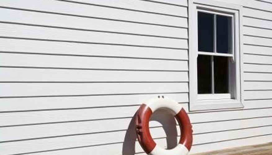 Installing windows with vinyl siding is simple.