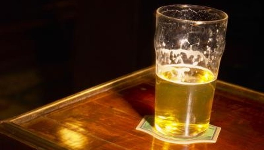 You can make a pub-style coaster water resistant with laminating paper.