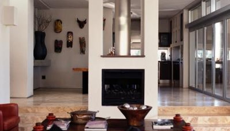Building a double-sided fireplace in the center of a room allows the fire to warm both sides of the space.
