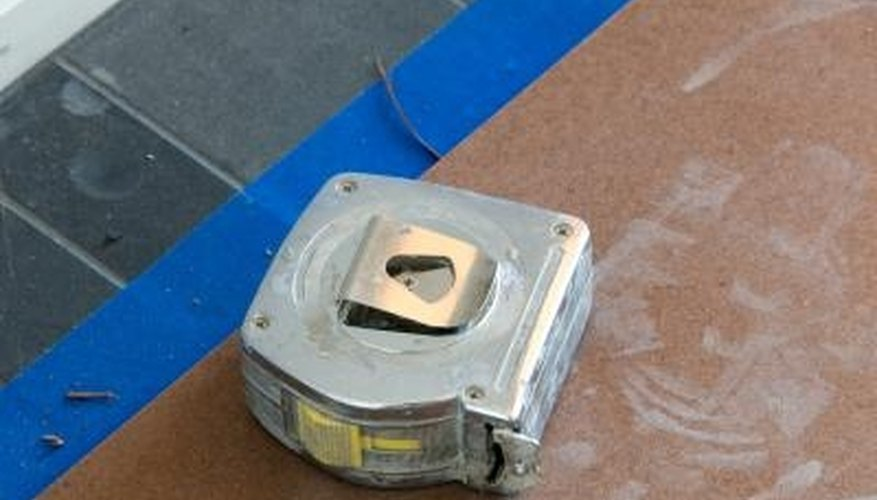 Have a tape measure on hand when cutting hard rubber.