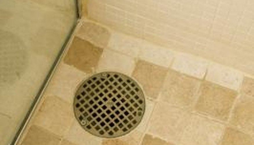 Hair and grimy buildup in shower traps often causes the water to drain slowly.