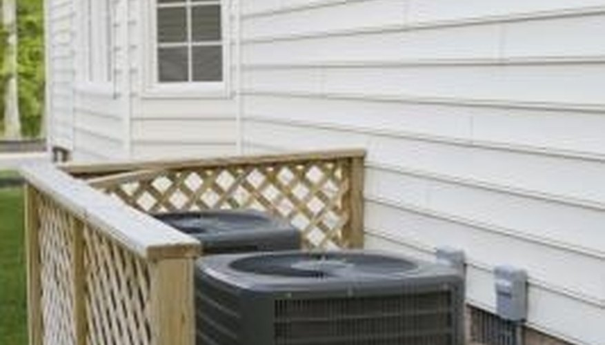 A fence is a logical choice for hiding outdoor air conditioning units.