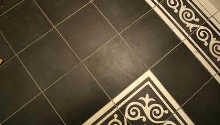 Brighten ceramic floor tiles with a thorough washing followed by a light wax.
